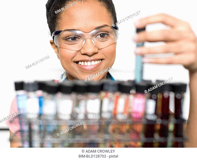Mixed race student examining samples in lab