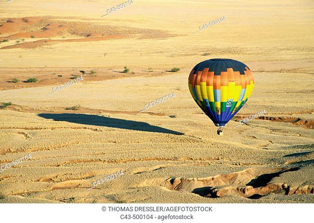 The hot-air balloon above eroded landscape at the edge of the Namib Desert. Namib-Naukluft Park, Namibia