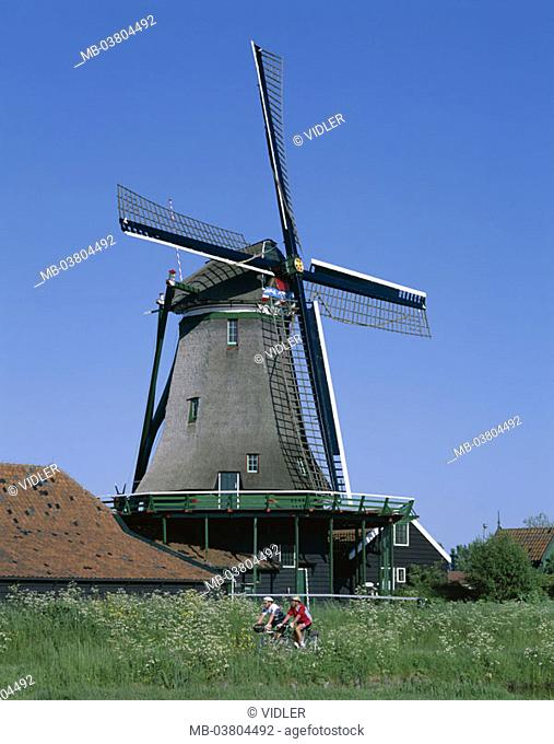 Netherlands, Holland, Zaanse Schans,  Museum village, close to Amsterdam,  Windmill, cyclists,  Sight, destination, vacation, trip, leisure time, tourism