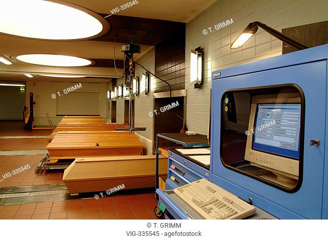 Cremation in Hamburg crematorium on the cemetery Hamburg Oejendorf. The picture shows coffins in front of the computerised entrance to the burner