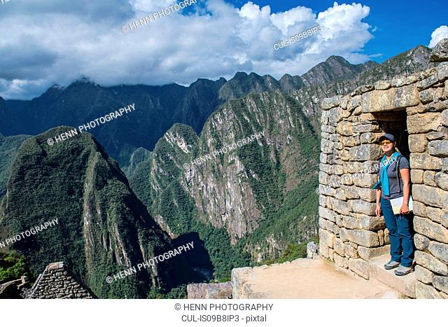 Woman in the ruins of Machu Picchu, Cusco, Peru