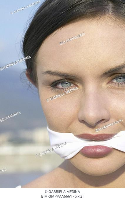 Young woman wearing gag
