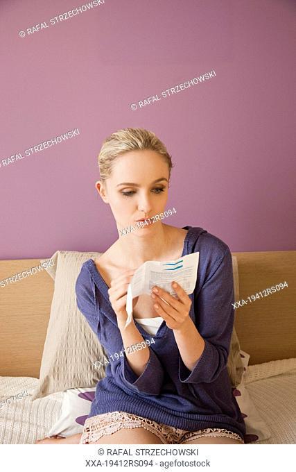 Woman reading medicine information