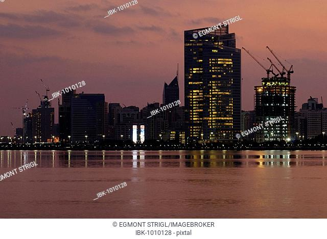 Abu Dhabi skyline at dawn, Emirate of Abu Dhabi, United Arab Emirates, Middle East