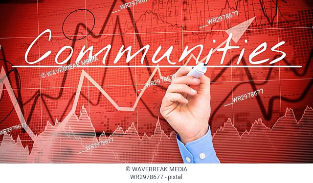 Businessman hand writing COMMUNITIES on the screen. Stock market, red background