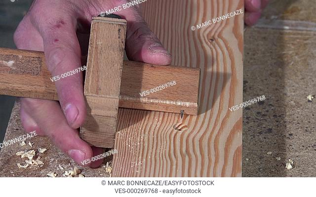 Tracing and drilling of a wooden board
