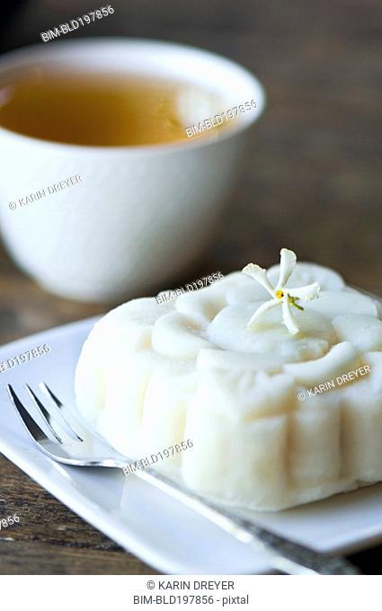 Close up of jasmine tea and rice cake