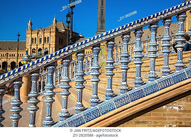 detail of bridge with colorfull tiles at plaza de espana, sevilla, spain