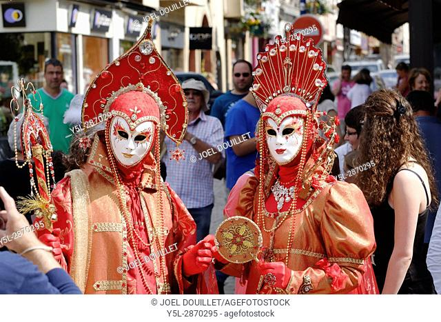 Venetian carnival masks and costumes at the Venetian Carnival of Mayenne city (Loire country, France)