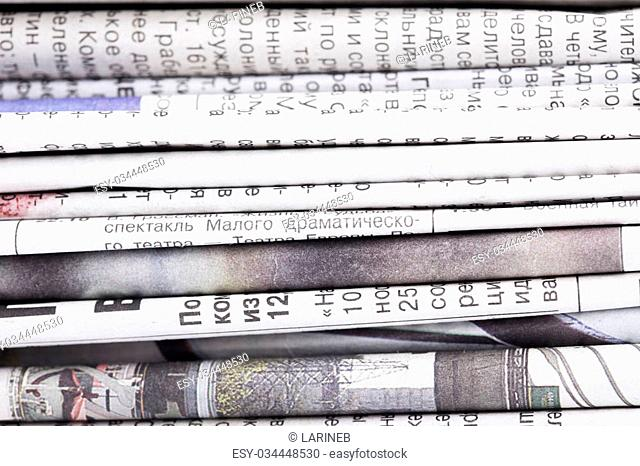 stack of old Newspapers close up background