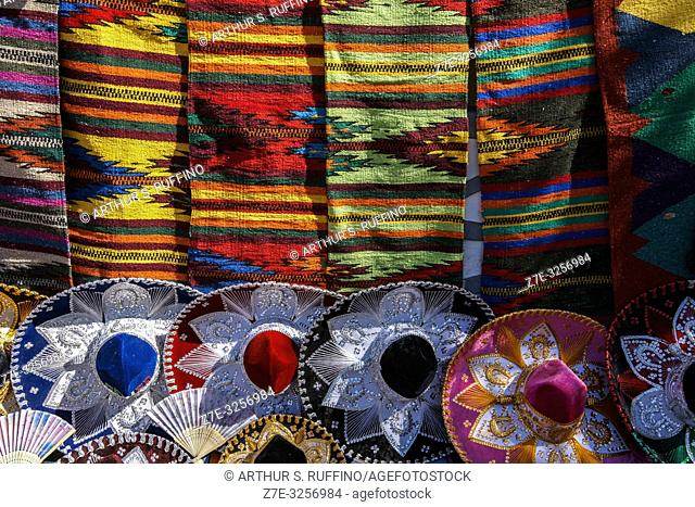 Colorful sombreros and textiles. Shopping for local crafts in downtown Loreto. UNESCO World Heritage Site. Loreto, Baja California Sur, Mexico