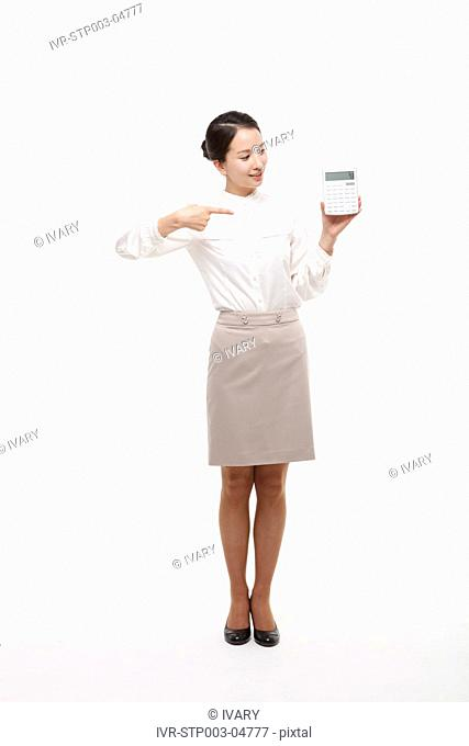 A young woman posing with a calculator