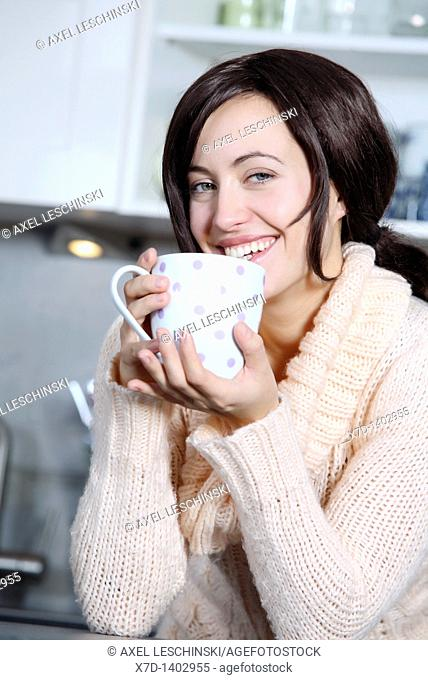 woman drinking a cup coffee