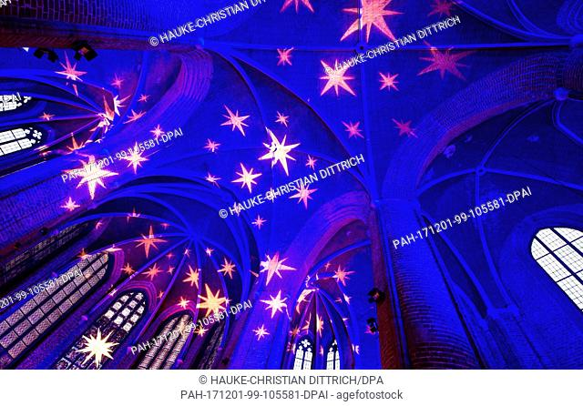 """Picture of the festively illuminated Marktkirche in Hanover, Germany, 01 December 2017. The parish is holding a festive """"""""Advent Calendar"""""""""""