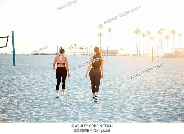 Friends walking on beach, Long Beach, California, US