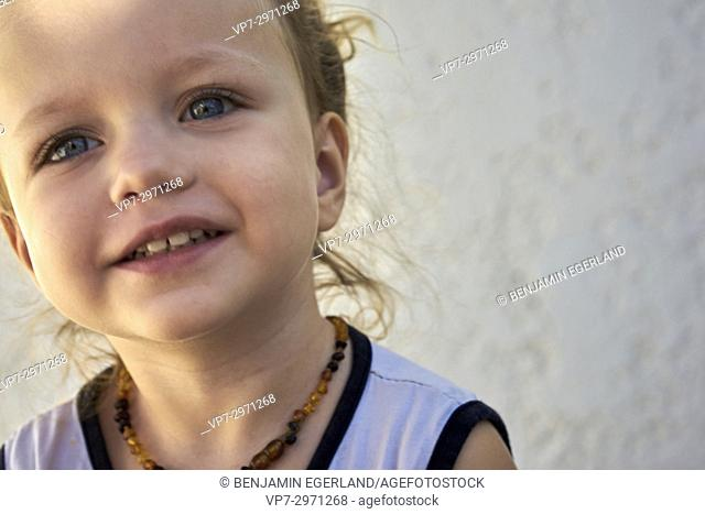 close-up of little child in sunlight. Australian ethnicity