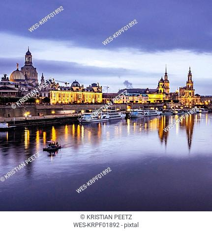 Germany, Saxony, Dresden, historic old town with Elbe River in the foreground in the evening