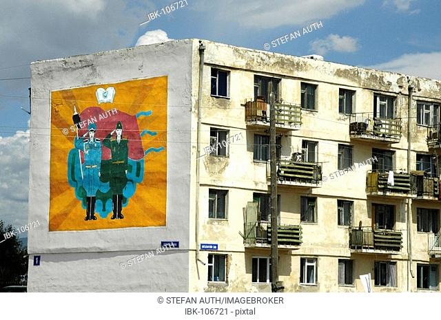 Sowjet style appartment house with a painting of socialistic propaganda Ulaan Baatar Mongolia