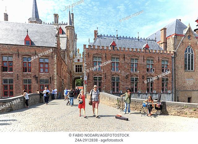 Bruges, Belgium - July 7, 2017: Tourists walking in the narrow streets in the center of Bruges. Bruges is also called the Venice of the North due to the...