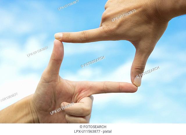 Finger Frame and Sky