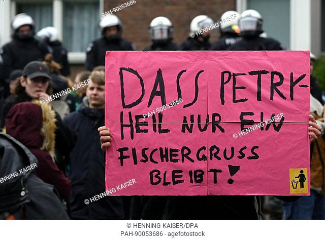 A protestor with a placard during demonstrations against the Alternative for Germany (AfD) party convention in Cologne, Germany, 22 April 2017