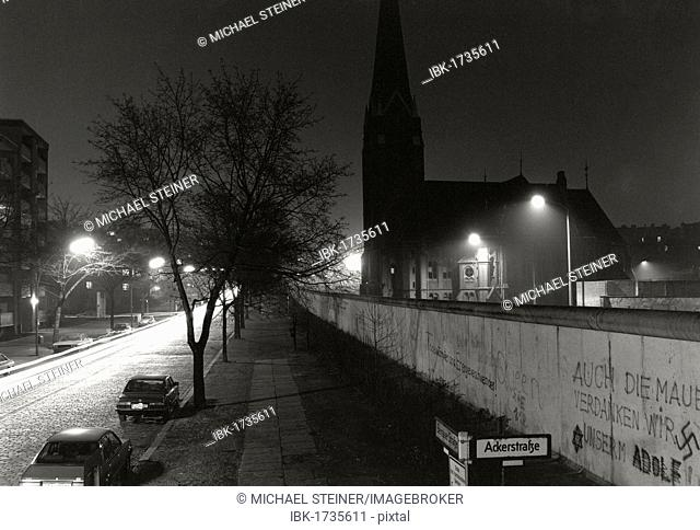 View over the Berlin Wall in the winter of 1985, Bernauer Strasse with the Church of Reconciliation shortly before the demolition on the border strip, Berlin
