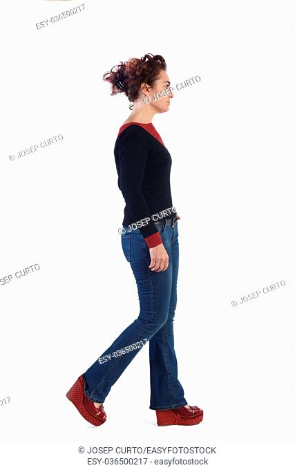 Woman with blue jeans walking on a white background