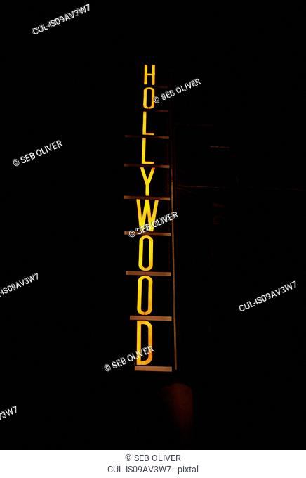 Neon Hollywood sign at night