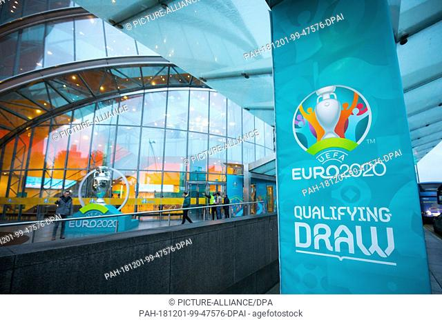 01 December 2018, Ireland, Dublin: Soccer: EM, UEFA, draw qualification groups for the EM 2020. An oversized trophy for the Euro 2020 is standing in front of...