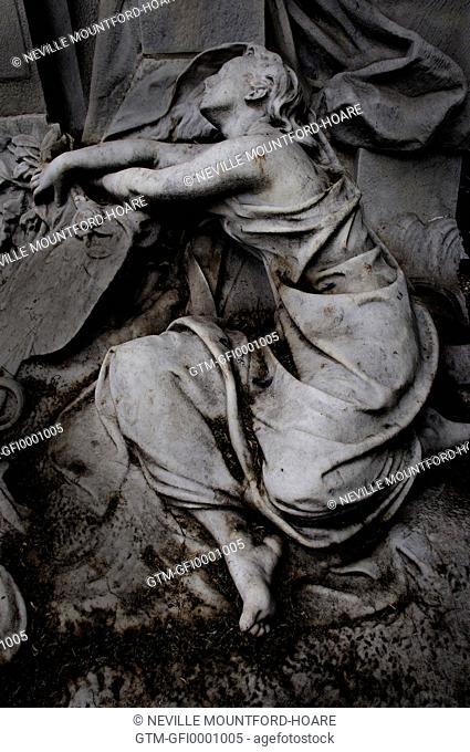 Statue on a grave in Monmartre cemetery in Paris