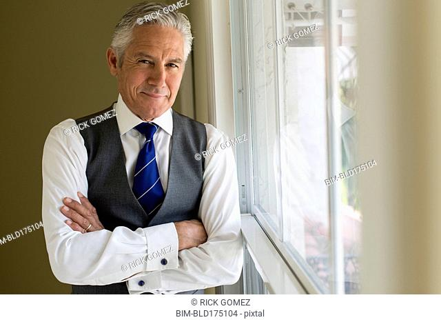 Caucasian businessman standing at window