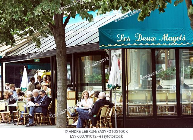 Patrons enjoying their drinks at one of the better known cafes in Paris