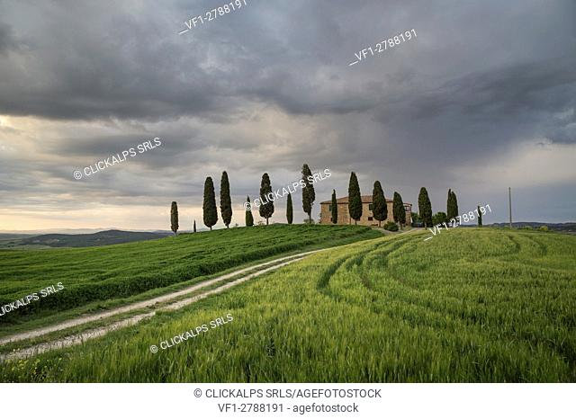 San Quirico d'Orcia, Tuscany, Italy. A farmhouse at sunset, during a stormy day