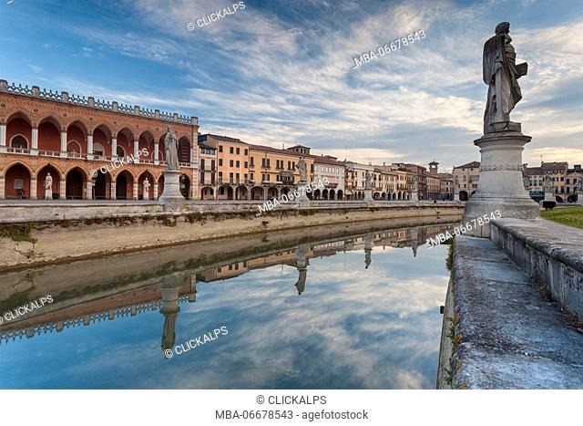 Europe, Italy, Veneto, Padua. Buildings reflected in the canal around Prato della Valle