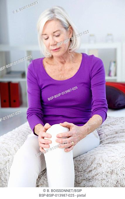 Senior woman with knee pain