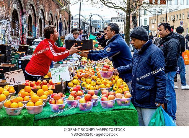 Men Buying Fresh Fruit From A Fruit Stall, Shoreditch, London, UK