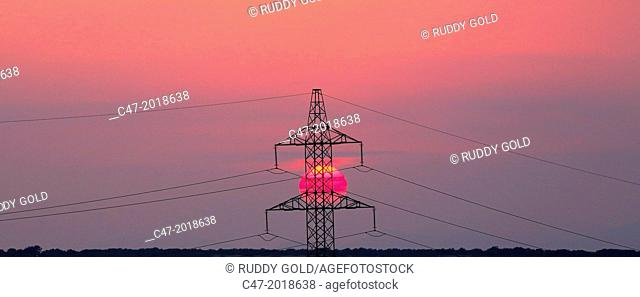 High Voltage electricity transmission tower, electricity pylon, at sunset taken near Sanahuja on the la Segarra area, Lleida province, Catalonia, Spain