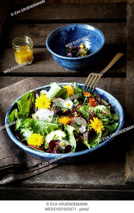 Bowl of mixed salad with edible flowers