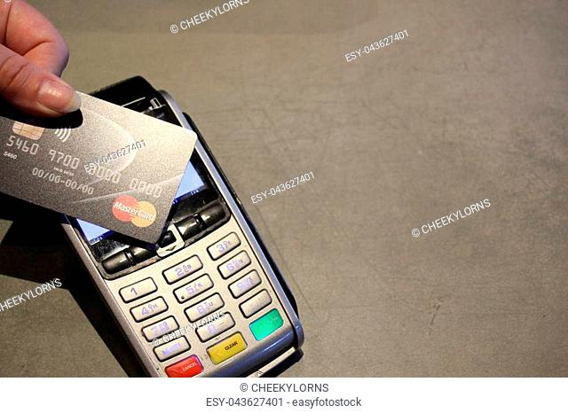 contactless payment card pdq with hand holding credit card ready to pay