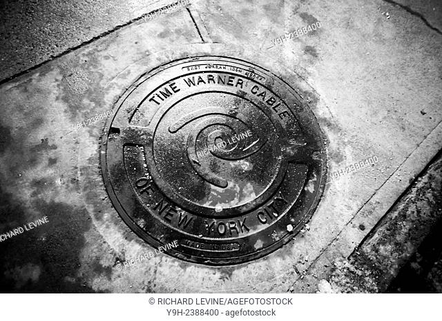 A Time Warner Cable labeled manhole in the Chelsea neighborhood of New York