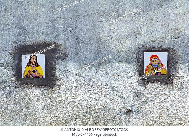 Tiles with images of Jesus Christ and Shirdi Sai Baba on the external wall of a residential condominium in Santacruz district, Mumbai, Maharashtra, India