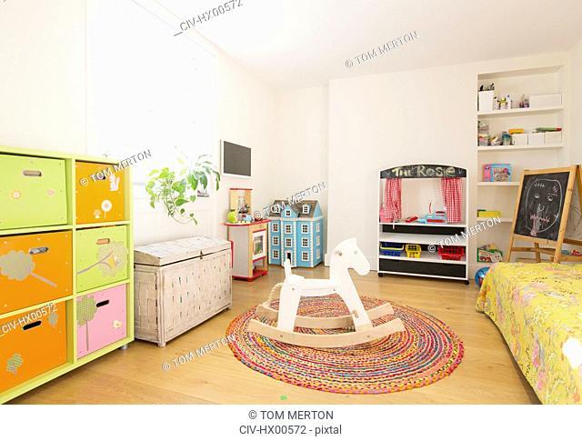 Wooden rocking horse in child's bedroom
