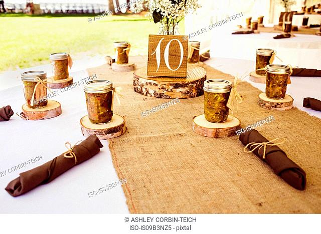 Wedding table with rustic place settings, outdoors