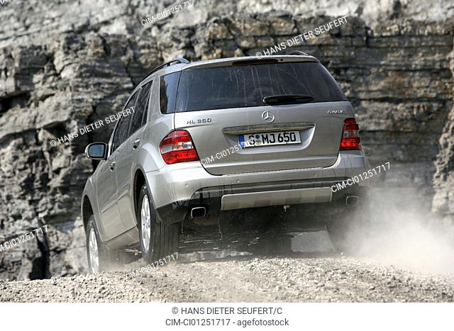 Mercedes ML 350, model year 2005-, silver, driving, diagonal from the back, rear view, offroad