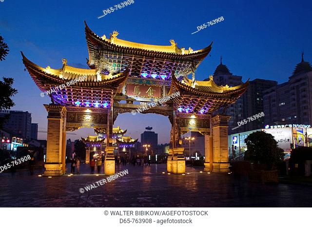China. Yunnan Province. Kunming: Memorial Arch of the Golden Horse and Jade Rooster in Jinmabiji Square / Evening