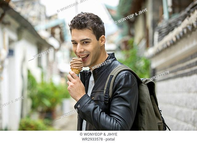 Portrait of young smiling male tourist