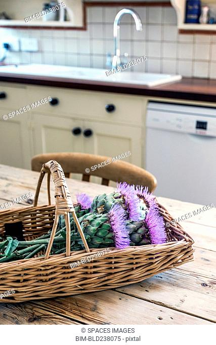 Basket of flowers in rustic domestic kitchen