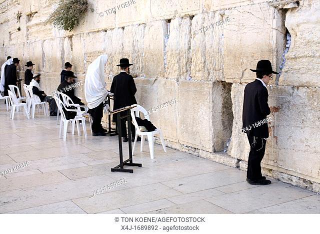 Jewish men gathered at the Western wailing wall in Jerusalem