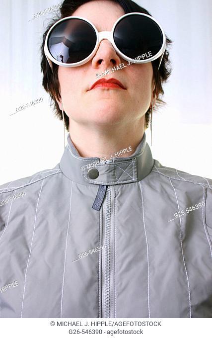 Woman in grey coat wearing funky sunglasses