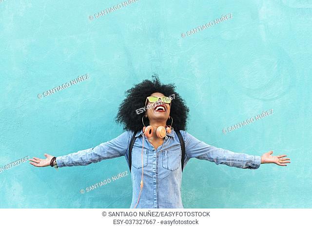 Portrait of beautiful afro american woman having fun in the street